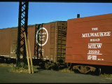 Railroad Box Cars with the Logos of the Atlantic Coast Line and Milwaukee Road Railroads