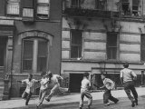 Young Boys with Sticks  Running Around While Playing a Street Game in Spanish Harlem