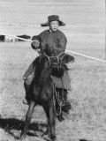 Shaggy Horse is Ridden by Mongolian Herdsman