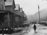 Small Girl Walking Down the Poverty Stricken Town of Hemphill in Appalachia