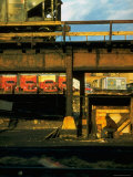 Moody Sunlight Showing Arty Grouping of Hopper Car  Rusting Elevated Span  Trucks  Etc