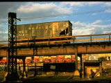Moody Sunlight Showing Hopper Car of the Reading Railroad Idle on Rusting Elevated Span