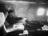 Richard M Nixon Working on Board Plane