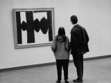 People Looking at a Painting by Robert Motherwell at an American Art Show