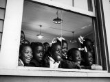 Students Looking Out the Window of the All Black Thomy Lafon School