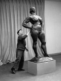 People Looking at a Sculpture by Artist Gaston Lachaise at an Art Show of American Art in France