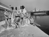 Russians Playing in the Snow in Swimming Gear  Preparing to Go Swimming