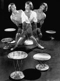 Multiple Exposure Showing Woman Oscillating on a Teeter Seat Designed by Isamu Noguchi