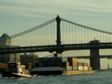 Tugboat Pulling a Barge on the East River Under the Manhattan Bridge