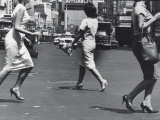 Women Walking Across the Street Wearing Spike Heels