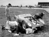 Men Fixing Their Race Car During the Grand Prix
