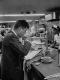 Senator John F Kennedy Drinking a Cup of Coffee at a Cafe in Washington Airport
