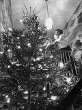 Mrs George Sutton and Her Family Decorating Their Christmas Tree at Home