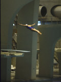 Athlete in Mid Air During a Platform Dive at Summer Olympics