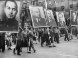 Spectators and Marchers in Prague May Day Parade  Many Carrying Large Pictures of Heroes
