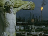 A Crucifixion Statue in Holy Rosary Cemetery Overlooks Petrochemical Plants