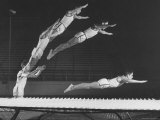 Multiple Exposure Shot of a Gymnast Jumping on a Trampoline