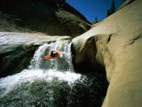 Suspended in Mid-Air  a Kayaker Sails Down a Short Waterfall and is Headed for White Water Below