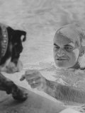 Arizona Senator Barry Goldwater Playing with His Dog While Swimming in His Pool at Home