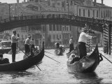 People Riding in Gondolas on the Grand Canal Near the Academia Bridge