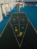 Woman Playing Shuffleboard Game on a Cruise Ship