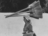 Street Scene with Woman Carrying Brooms on Her Head