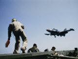 A Fighter Plane Lands Onboard an Aircraft Carrier