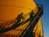 A Workman Climbs a Stairway on a Petroleum Storage Tank