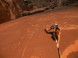 A Young Woman Climbing in Canyonlands National Park