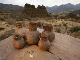 Wari Indian Vessels and Beads with Wari Ruins in the Background