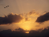 Three US Navy F-185 Jets Silhouetted against the Evening Sky