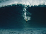 A Surfer Rides a Powerful Wave off the North Shore of Maui Island