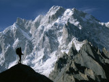 A Man Stands Silhouetted against the Karakoram Mountains  Pakistan