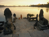 Two Buddhist Monks Sit at the Waters Edge at a Lake Temple in the Angkor Wat Complex