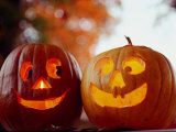 A Cheerful Pair of Jack-O-Lanterns against a Background of Fall Foliage