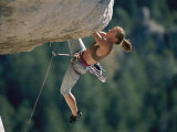 A Female Climber Negotiates an Overhang