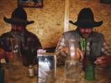 A Pair of Cowboys Enjoy a Cup of Coffee at a Local Restaurant