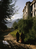 Monks Walk along a Path outside a Monastery
