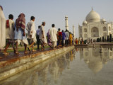 A Line of Pilgrims Visiting the The Taj Mahal