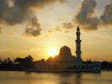 A View of a Mosque Silhouetted by the Setting Sun