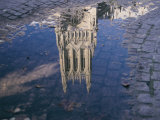 A Puddle Reflects the Central Tower of the Majestic Washington National Cathedral