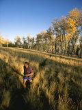 A Man Runs Through a Meadow of Tall Grass Near Mt Elden