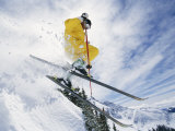 A Skier in a Yellow Suit Goes Airborne