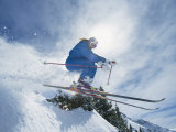 A Skier Crouches as He Takes a Leap into the Air