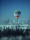 Hot Air Balloon Hovers Over a Snowy Landscape