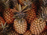 A Group of Pineapples at an Open-Air Fruit Market