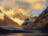 Clouds over Patagonias Snow-Covered Cerro Torre Massif