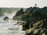 Kayaker Carries Boat up the Rocks of Great Falls on the Potomac River