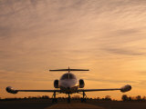 Twilight View of a Lear Jet on the Runway