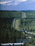 The Trans-Alaska Pipeline Cuts Through Wilderness Towards Mountains